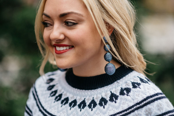 Bows & Sequins wearing a fair isle winter sweater and bon bon earrings!