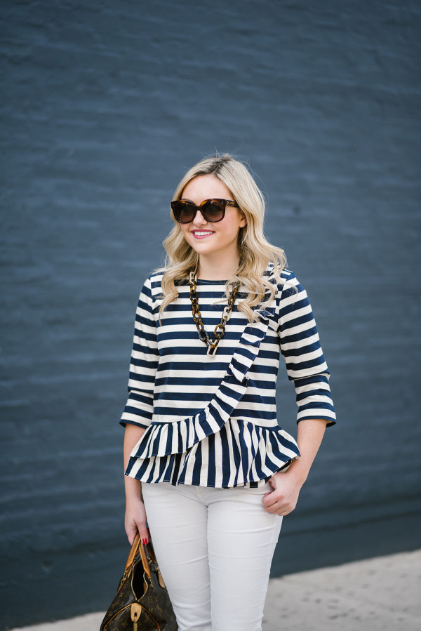 Bows & Sequins wearing a J.Crew ruffled striped peplum shirt with tortoise Celine sunglasses and a tortoise link necklace.