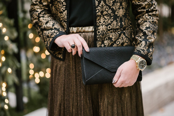 Bows & Sequins wearing a festive black and gold outfit.
