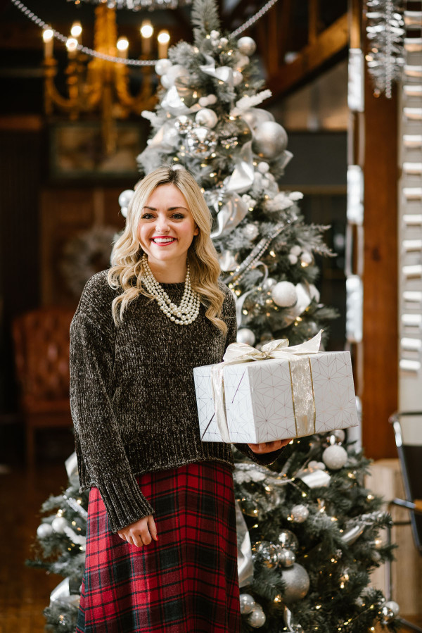 Bows & Sequins styling an outfit perfect for a casual holiday party or Christmas with family! Green chenille sweater layered over a plaid dress with pearls!