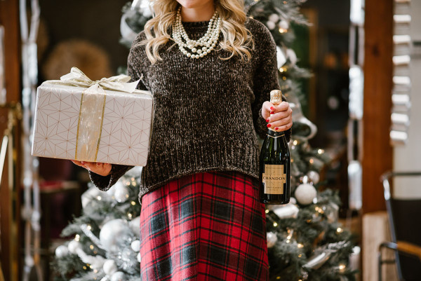 Bows & Sequins styling an outfit perfect for a casual holiday party or Christmas with family! Green chenille sweater over a plaid dress with pearls! Gifts and champagne help, too.