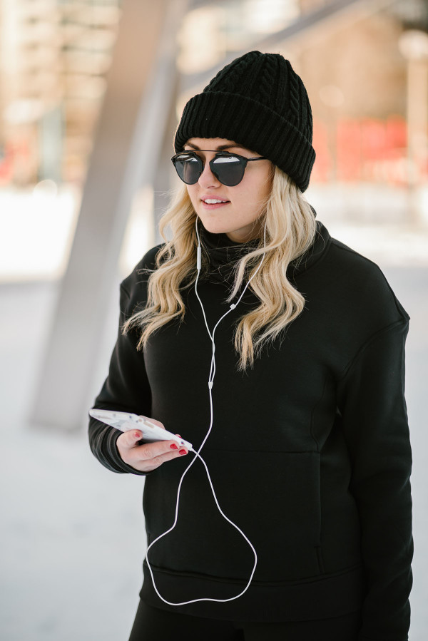 Bows & Sequins wearing a lululemon turtleneck, black sunglasses, and a beanie.