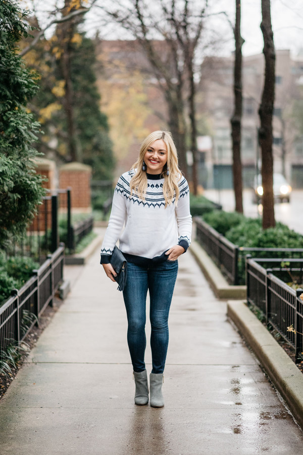 Bows & Sequins wearing a casual outfit for the holidays: fair isle sweater, skinny jeans, and ankle booties.
