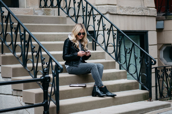Bows & Sequins styling a pair of black ankle booties in Chicago.
