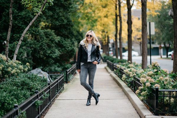Bows & Sequins styling a moto jacket and grey skinny jeans for fall in Chicago.