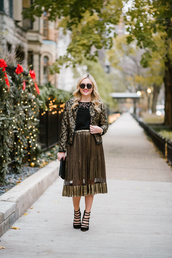 Bows & Sequins styling a shimmery gold midi skirt and a black and gold jacket for a holiday party or New Years Eve.