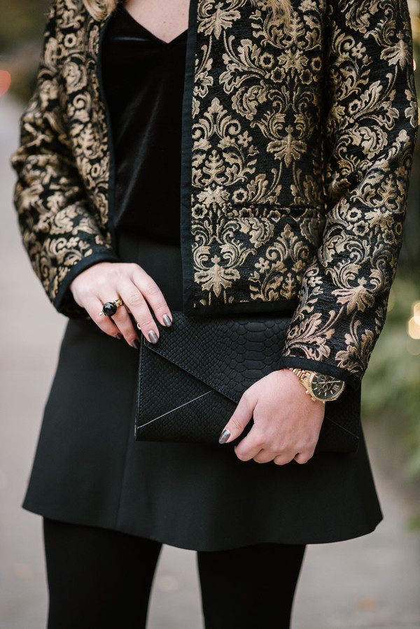 Bows & Sequins wearing a black and gold outfit perfect for a holiday party.