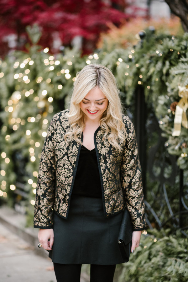 Jessica Sturdy, Chicago-based fashion, travel, and lifestyle blogger, styling a black and gold embroidered jacket for the holidays.