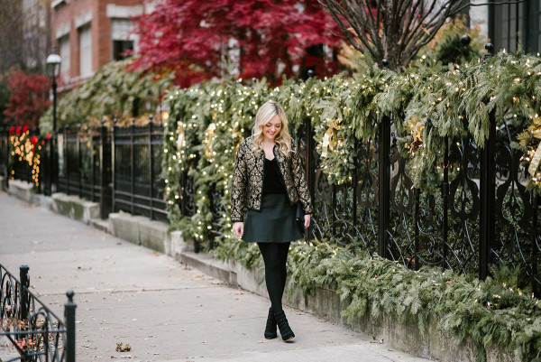 Bows & Sequins, Chicago-based lifestyle blogger, styling a black and gold jacket, velvet cami, and fluted skirt for a festive holiday party.