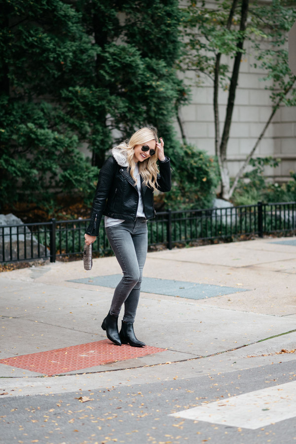 Jessica Sturdy, Chicago-based fashion and travel blogger, wearing a Topshop leather jacket, grey jeans, and Marc Fisher booties.