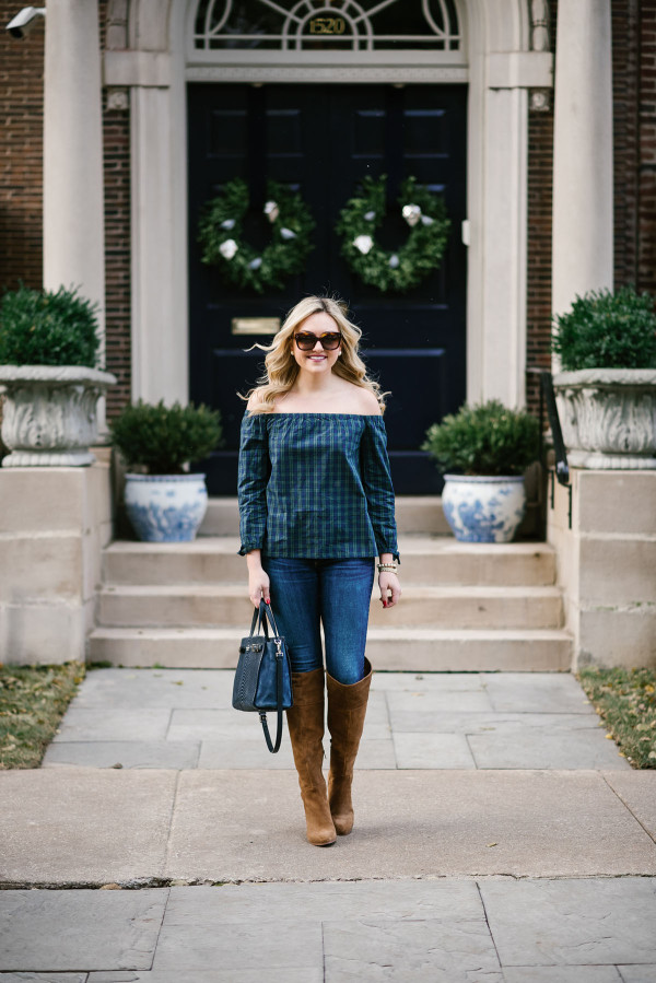 Bows & Sequins wearing a Vineyard Vines blackwatch plaid off-the-shoulder shirt, Rag & Bone skinny jeans, and tan suede over-the-knee boots.