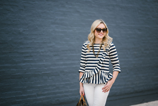 Bows & Sequins wearing a J.Crew striped ruffled shirt with white jeans.