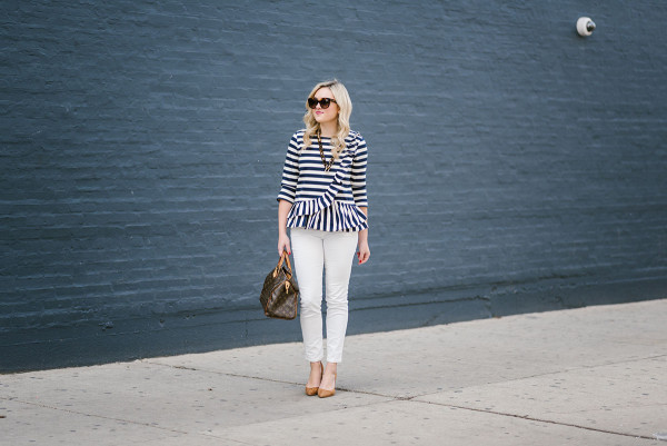 Bows & Sequins wearing a striped top with white corduroys, suede pumps, and tortoise accessories.