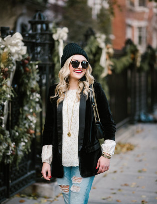 Bows & Sequins styling a black velvet blazer with a beanie and boyfriend jeans.