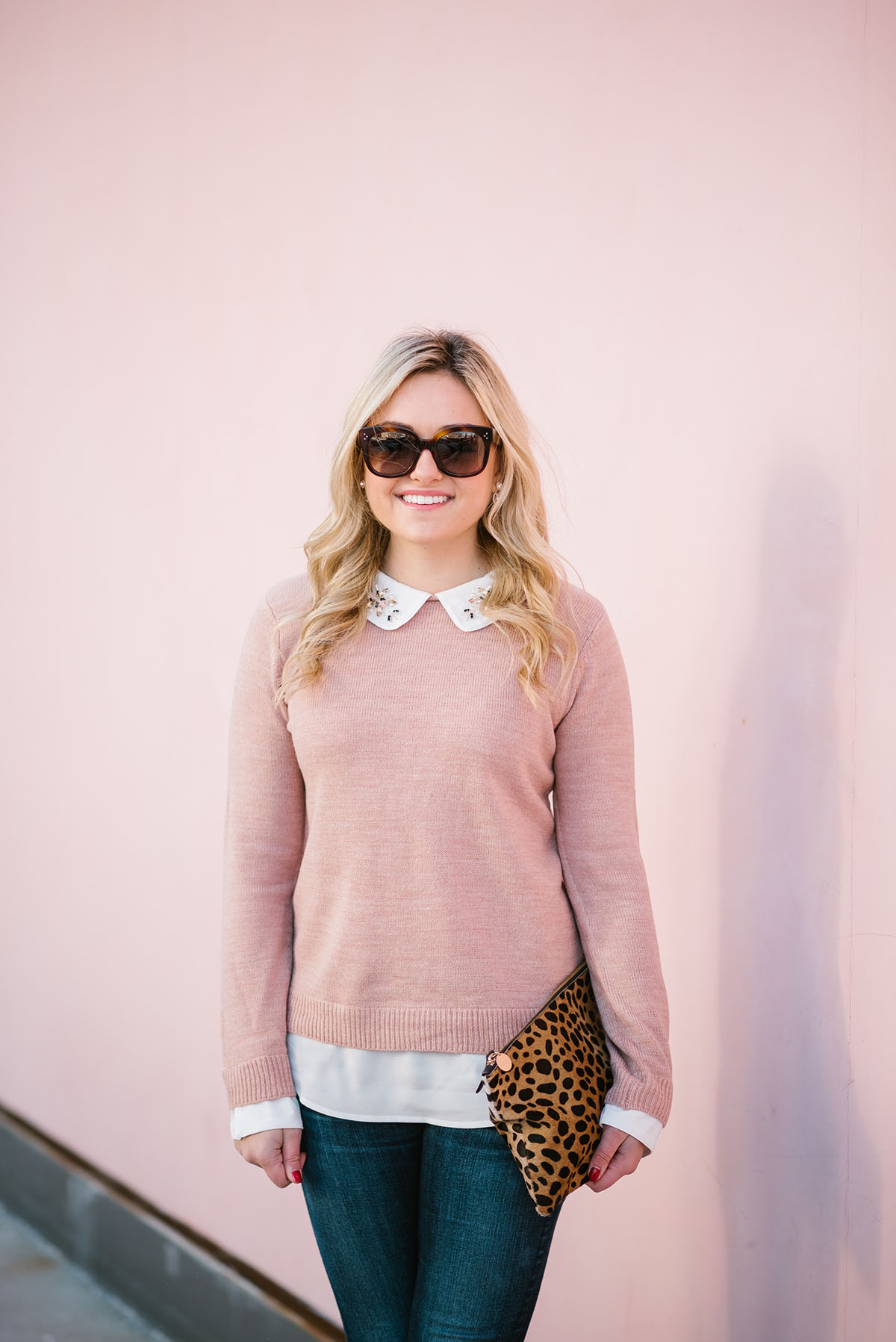 Bows & Sequins wearing a layered blush pink sweater with Celine sunglasses and a Clare V leopard clutch
