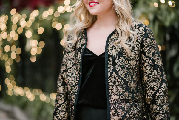 Bows & Sequins wearing a black & gold embroidered jacket and black velvet top for a holiday party.