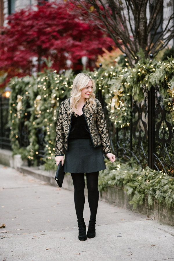 Jessica Sturdy, Chicago-based fashion, travel, and lifestyle blogger, styling a black and gold embroidered jacket and velvet cami for the holidays.