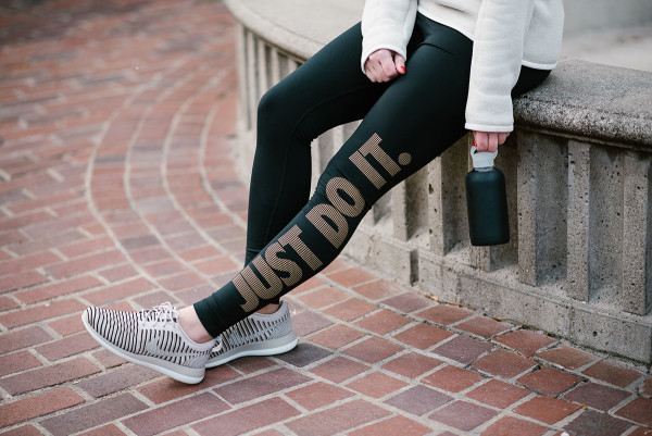 Bows & Sequins wearing a pair of Just Do It leggings and Nike Roche Flyknit Sneakers.