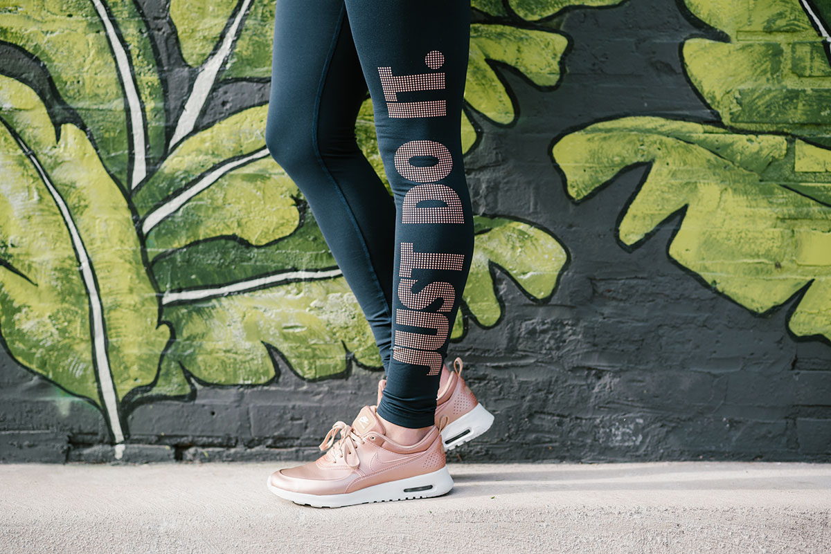 Bows & Sequins wearing navy & copper Just Do It leggings with Nike rose gold sneakers.