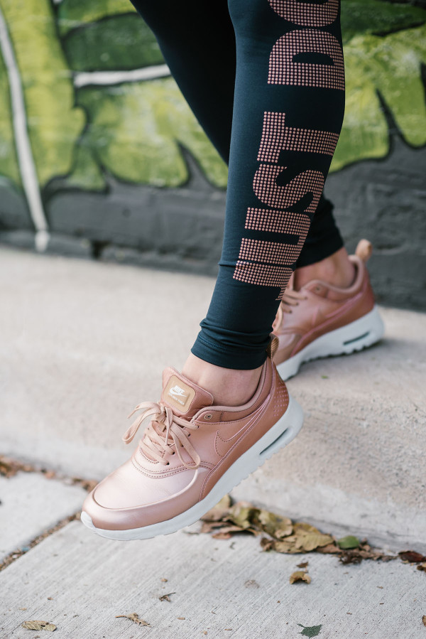 Bows & Sequins wearing rose gold Nike Air Max Thea sneakers.