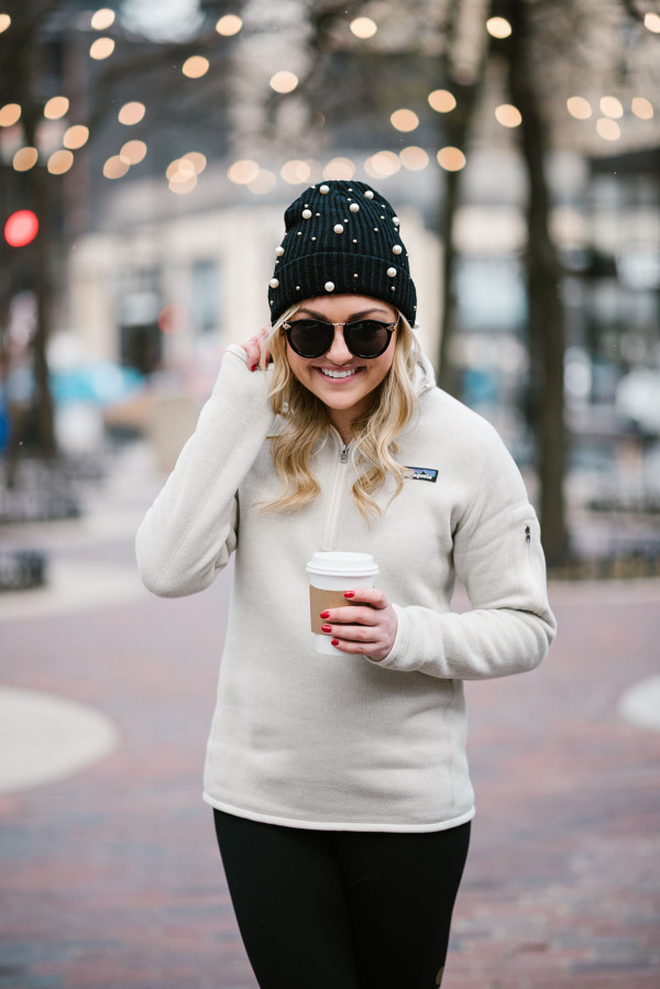 Bows & Sequins wearing a pearl beanie and a Patagonia pullover.