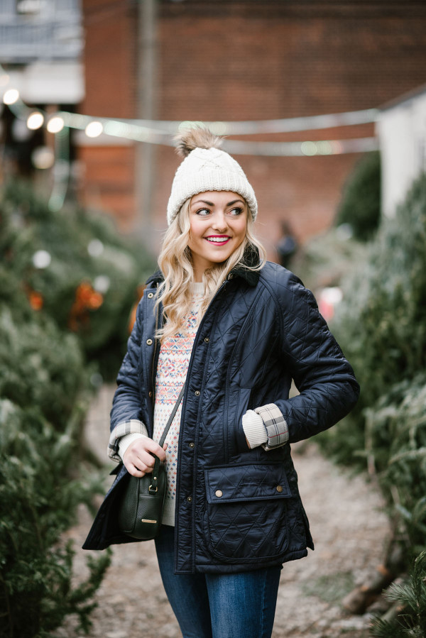 Bows & Sequins wearing a Barbour jacket, J.Crew Fair Isle Sweater, and a Tuckernuck pom pom beanie to pick out a Christmas tree in Chicago.