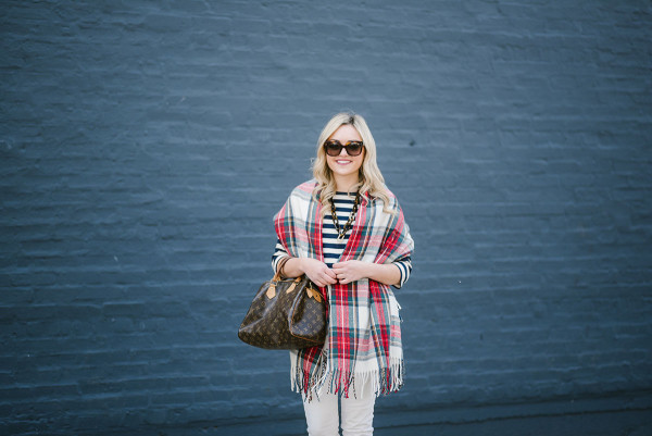 Bows & Sequins wearing a tartan plaid blanket scarf with a striped shirt and white jeans.