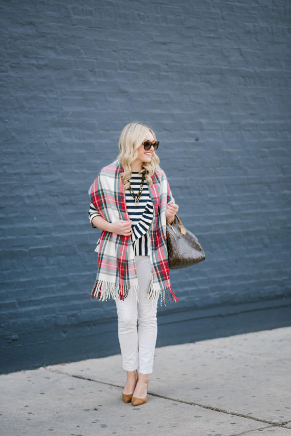 Bows & Sequins styling a plaid scarf over a striped top and white jeans.