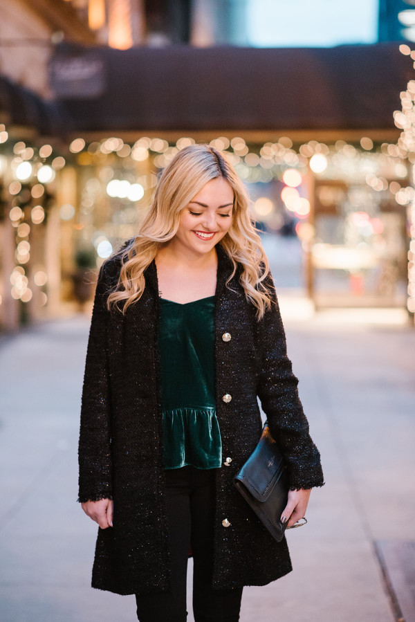 Bows & Sequins wearing a black tweed coat from Sail to Sable and a green velvet peplum top from J.Crew.