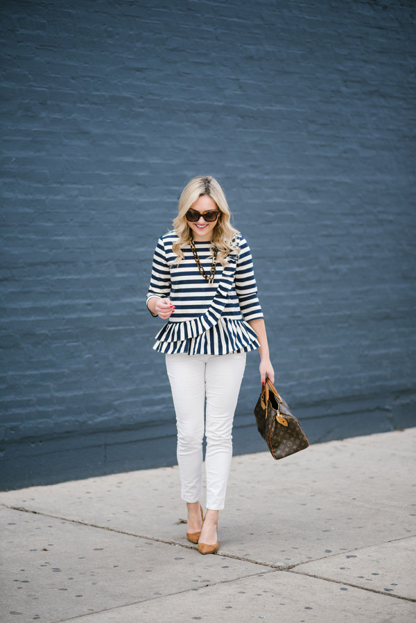 Bows & Sequins styling a ruffled, stripe peplum top with white corduroy jeans and suede pumps.