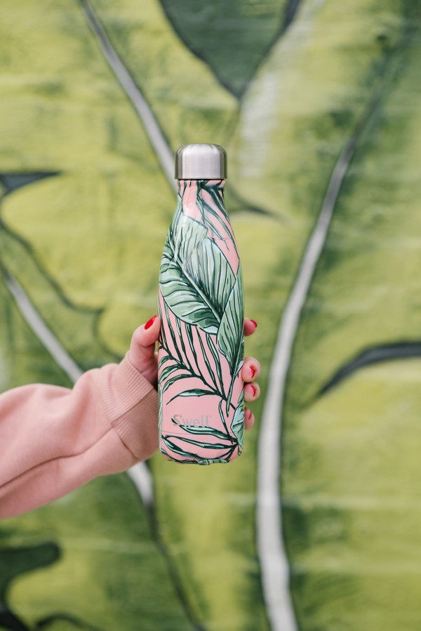 Bows & Sequins with the pink and palm leaf S'well Palm Leaf water bottle.