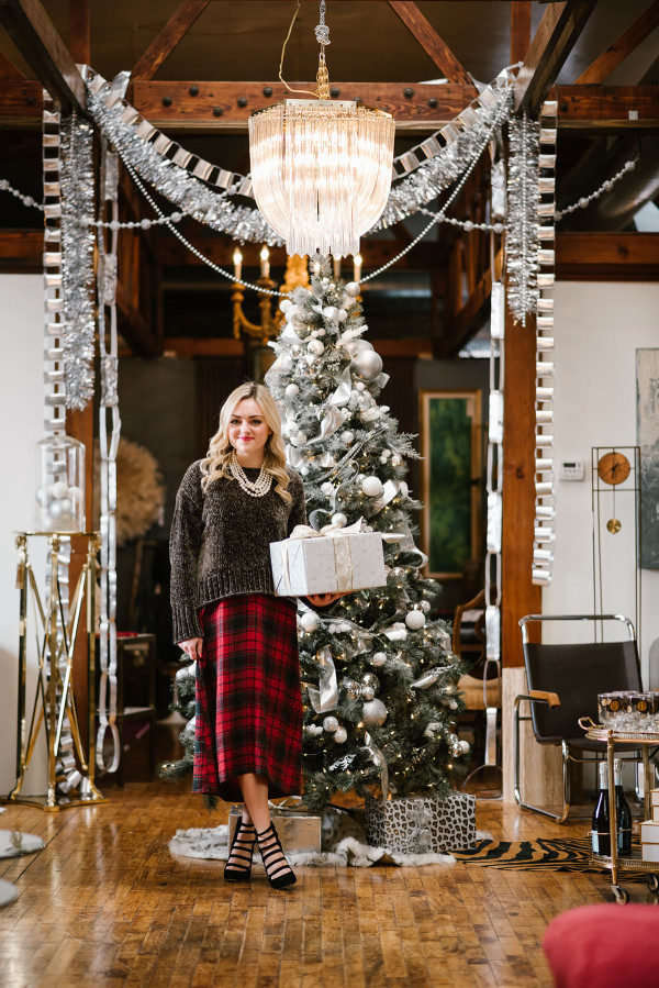 Bows & Sequins wearing an outfit perfect for a casual holiday party or Christmas with family! Green chenille sweater layered over a plaid dress with heels and pearls.