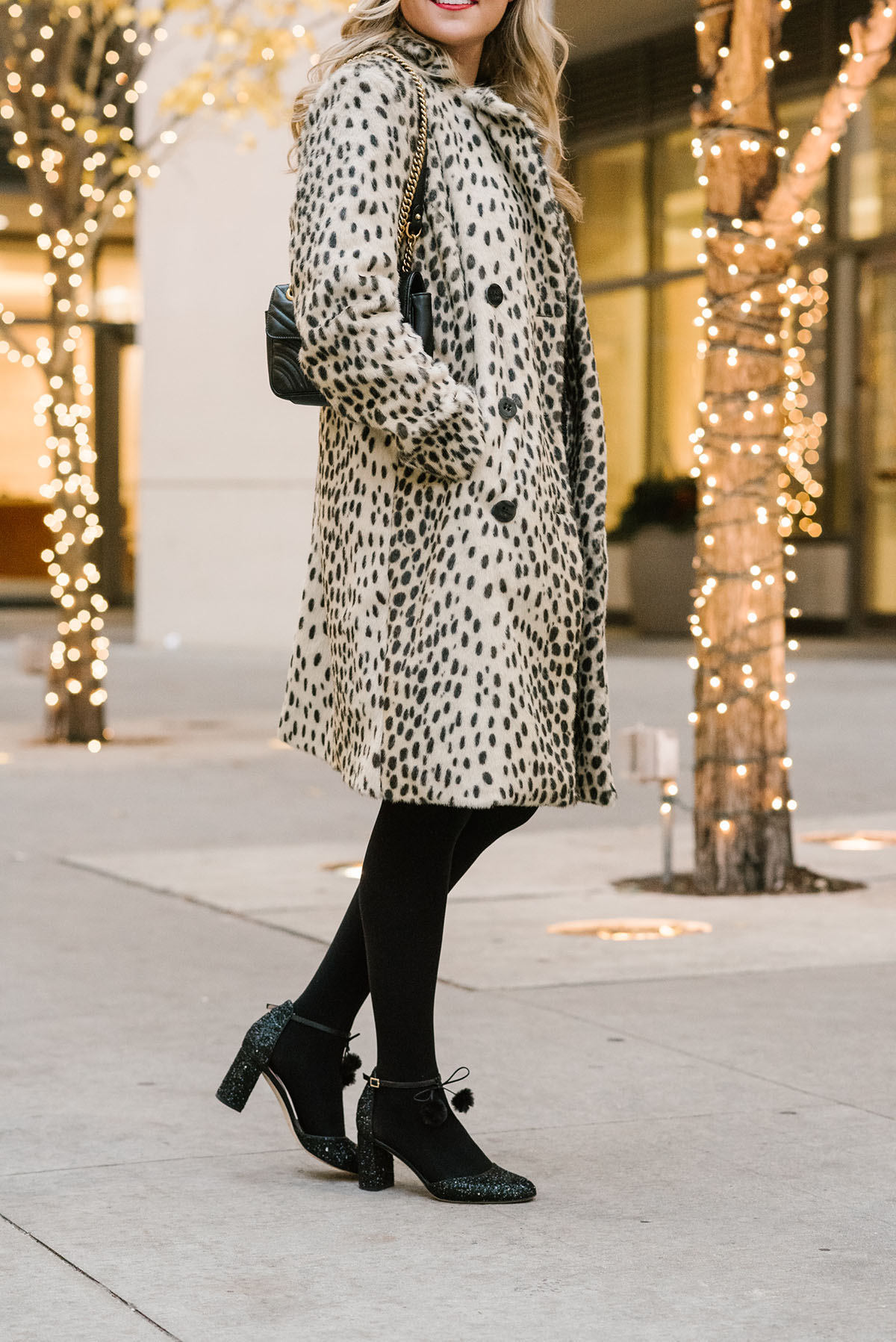 Bows & Sequins wearing an outfit for a holiday party in Chicago: Black Tweed Dress, Black Tights, Black Glitter Pumps, and a Leopard-Print Coat.
