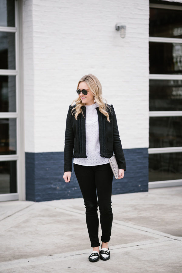 Bows & Sequins wearing a casual black and white outfit in Chicago.