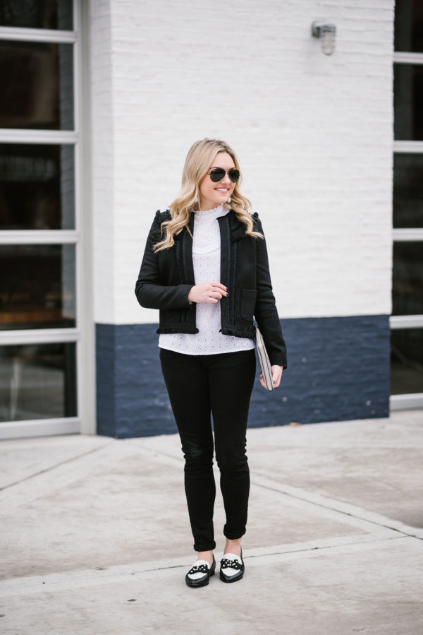 Bows & Sequins wearing a black textured jacket from Sezane, a white lace blouse from Sezane, black skinny jeans, and black & white bow pumps from Kate Spade.