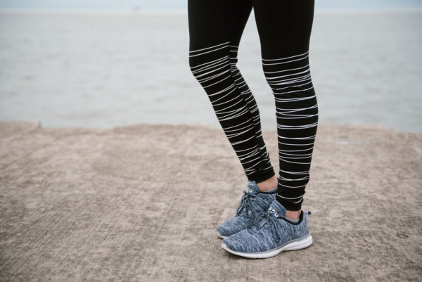 Bows & Sequins wearing Old Navy workout leggings and APL sneakers.