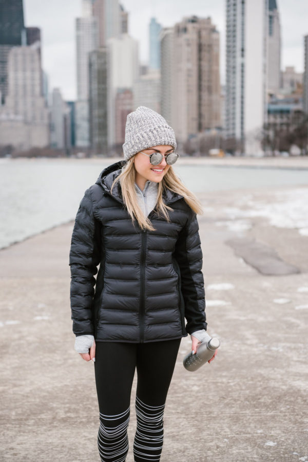 Bows & Sequins wearing a grey Love Your Melon beanie with a black puffer coat and mirrored sunglasses.