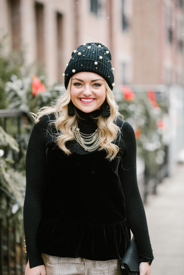 Bows & Sequins wearing a black velvet cami with a black turtleneck layered underneath.