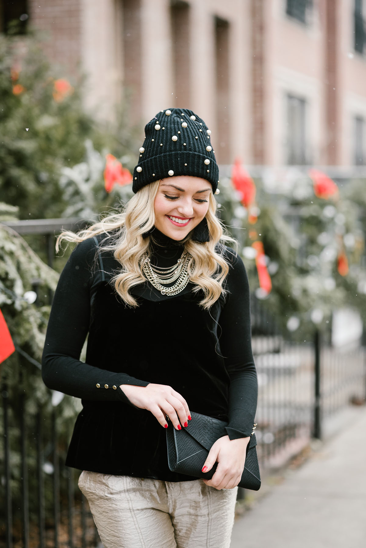 Bows   Sequins wearing a black velvet cami with a black turtleneck layered  underneath. b3847b1c31c
