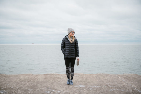 Bows & Sequins wearing cold-weather workout gear by Lake Michigan in Chicago.