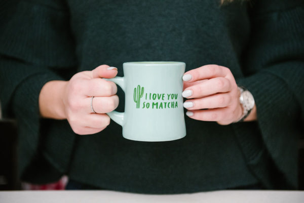 Bows & Sequins holding an 'I Love You So Matcha' mug.