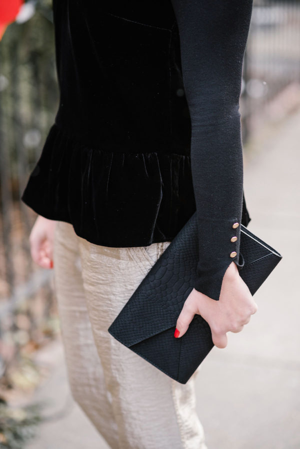 Bows & Sequins wearing J.Crew's black velvet peplum top.