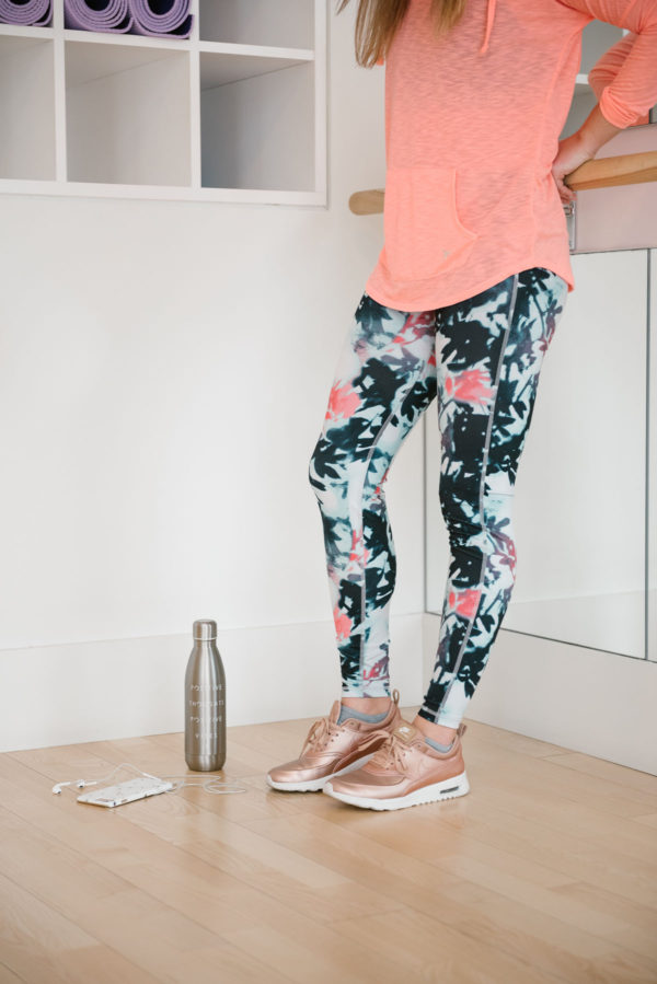 Bows & Sequins wearing Nike sneakers and printed yoga pants at fitness studio.