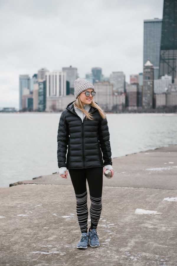 Bows & Sequins in black coat and black and white patterned workout leggings with gray beanie.
