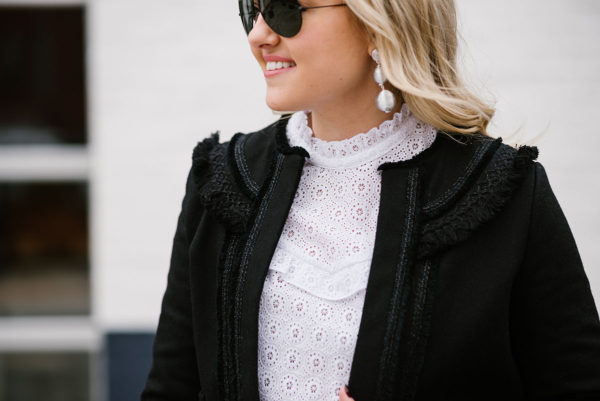 Bows & Sequins wearing a victorian lace top and a textured black jacket from Sezane Paris.