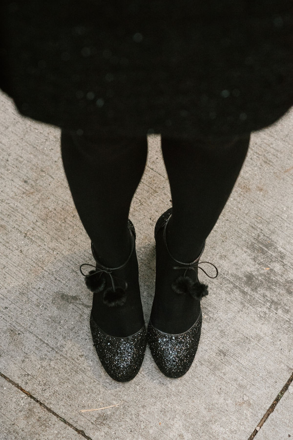 Bows & Sequins wearing Kate Spade Black Glitter Abigail Pumps with Pom-Poms.
