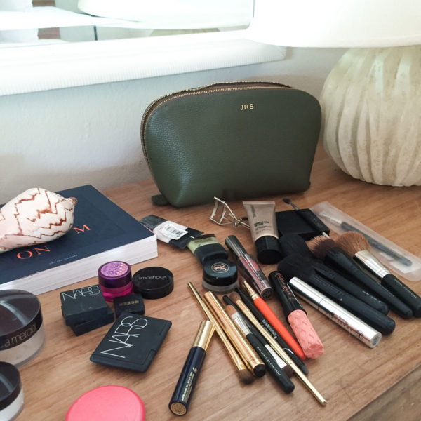 Bows & Sequins Makeup Bag in Caneel Bay: Cuyana Monogram Travel Cosmetic Bag, Nars Blush, Benefit Mascara, Bare Minerals Complexion Rescue, Laura Mercier, and more