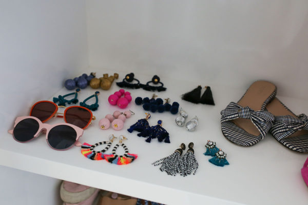 Bows & Sequins packing for vacation in Mexico with statement earrings