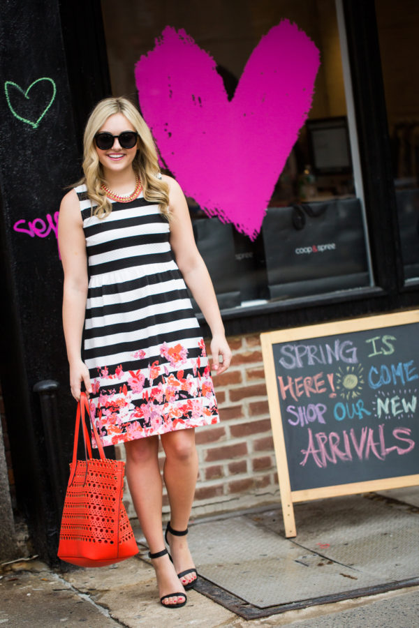 Bows & Sequins wearing a striped floral dress in Nolita in New York City.