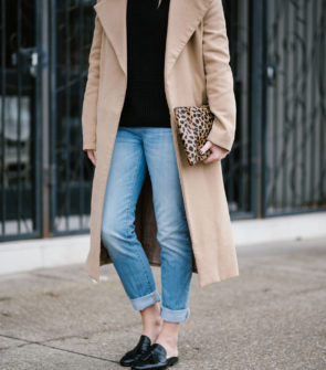 Bows & Sequins wearing a long camel coat with boyfriend jeans and black leather loafers.